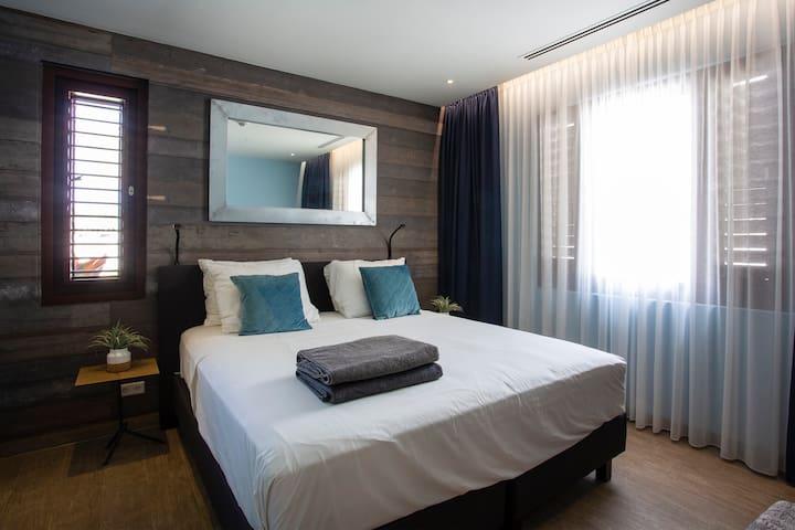 Bedroom 1 with adjoining bathroom