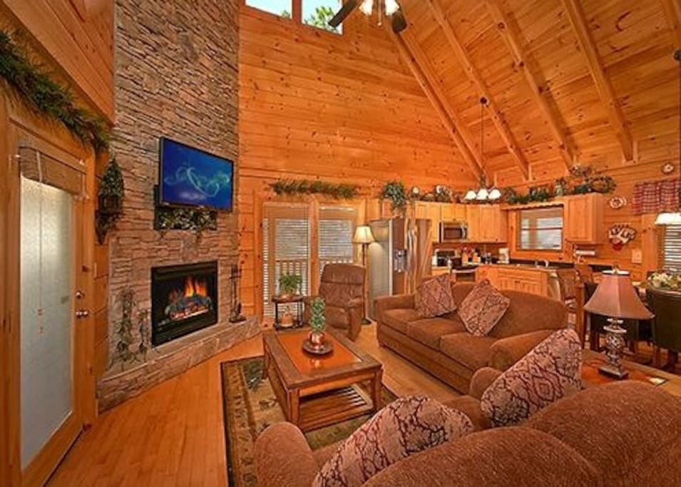 Living Room with Stone Stacked Fireplace