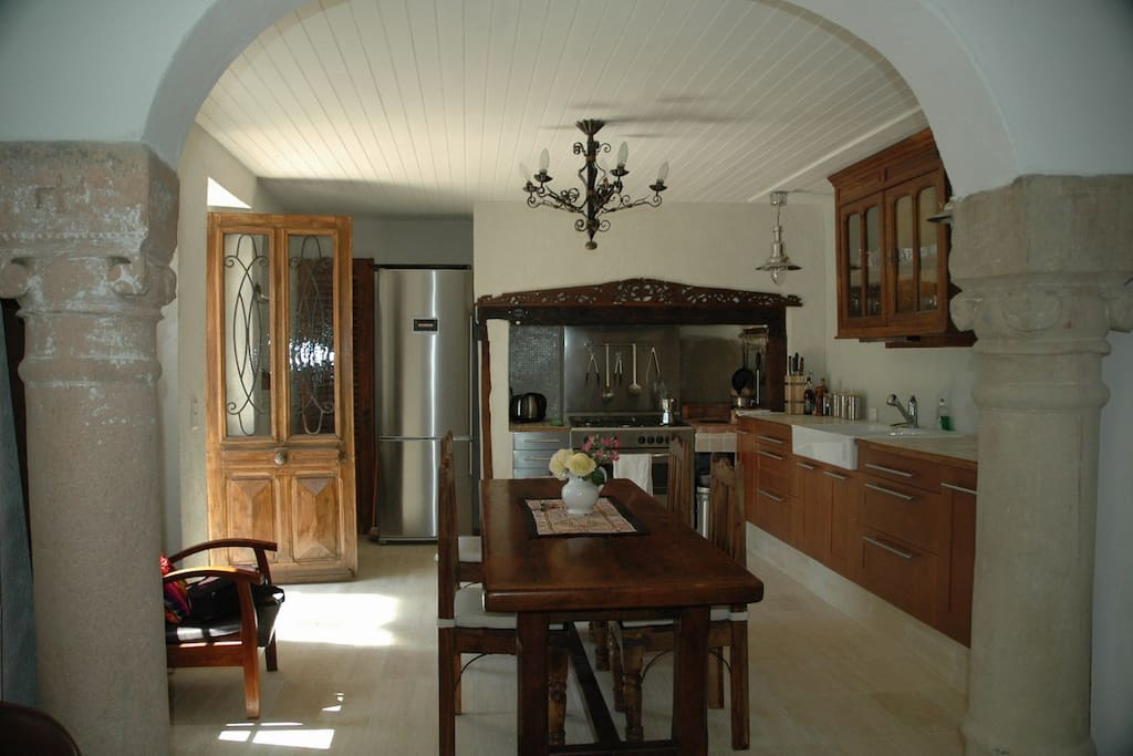 Charming but modern stainless steel kitchen plus dining for 6-8 guests.