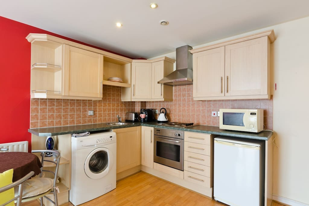 compact modern fitted kitchen equipped with all the appliances you need for a comfortable stay