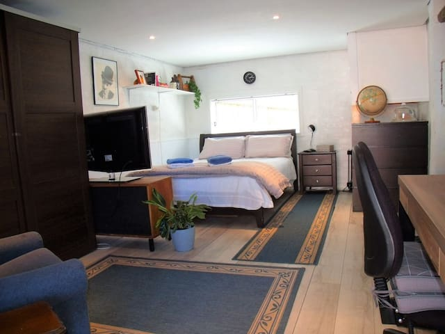 Bedroom with TV and plenty of wardrobe space