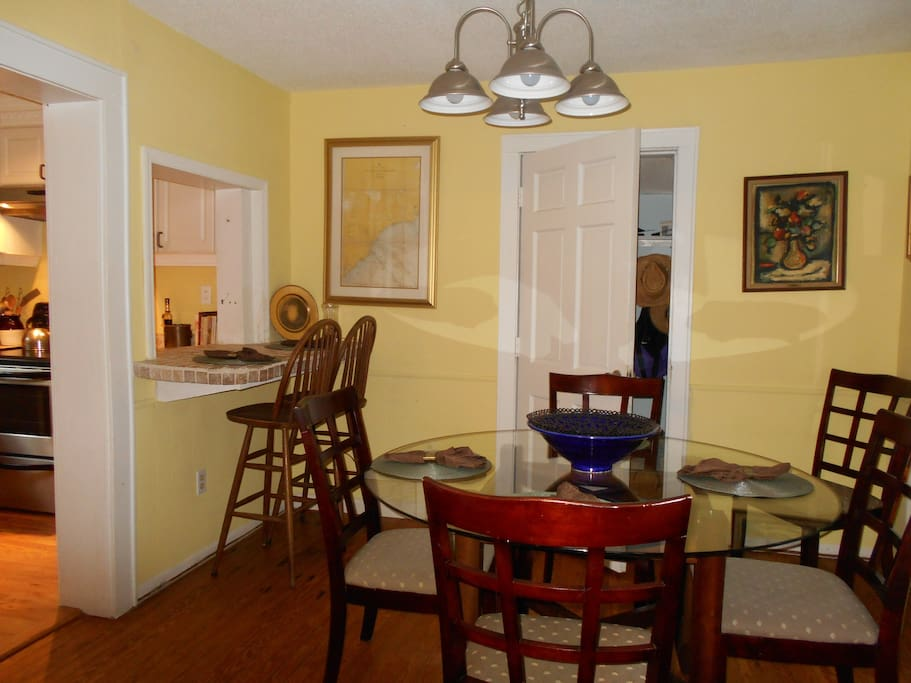 Dining room with repalcing with seating 12 .door leads to 1/2 bath for downstairs