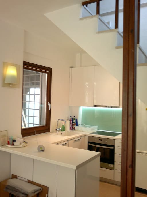 Renovated kitchen in communication with the outside patio.