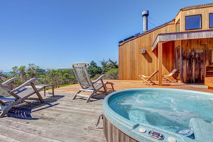 Contemporary coastal home with private hot tub, shared pool & ocean views!