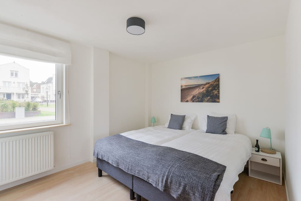 Large bedroom with two comfortable boxsprings including hotel quality bed linen + shutters for completely dark bedroom