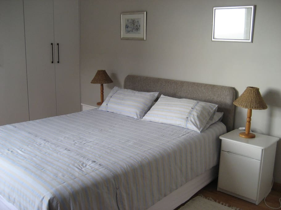 Bedroom with double bed and build in cupboards