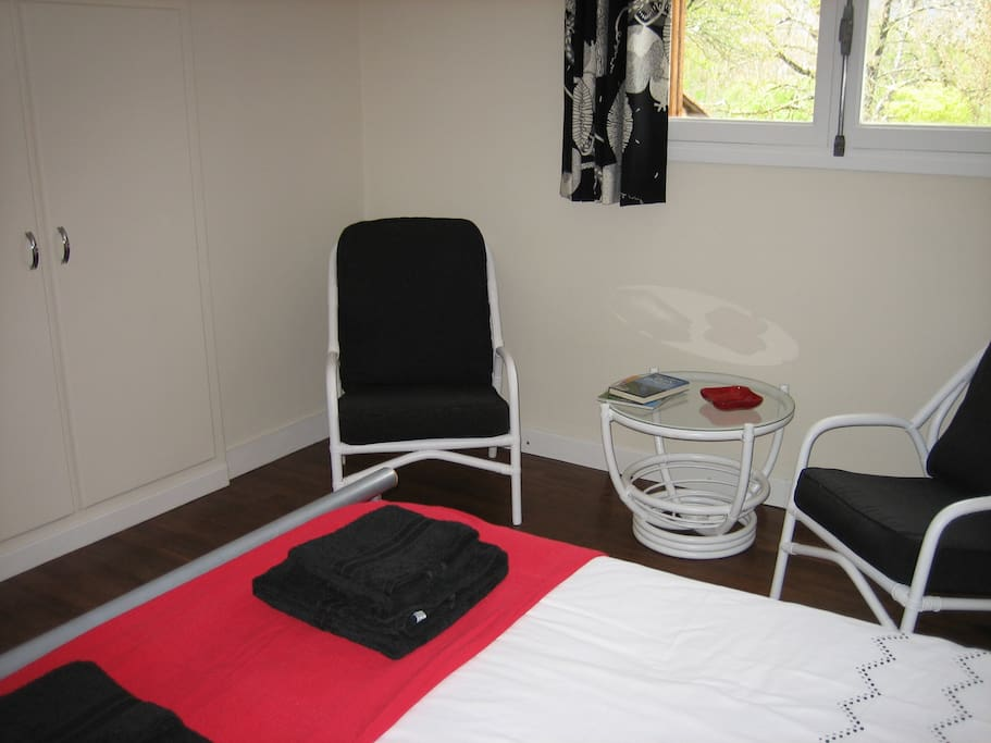 Double bedroom, includes two armchairs, coffee table,   wardrobe and bed side tables.