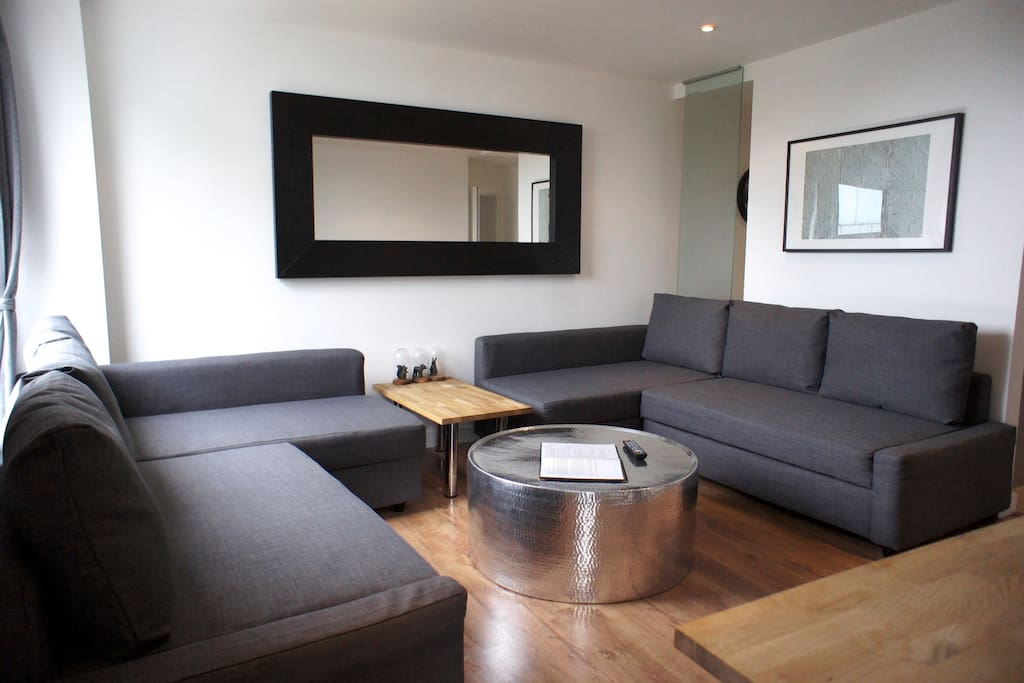 Here's your living room with two double sofa beds