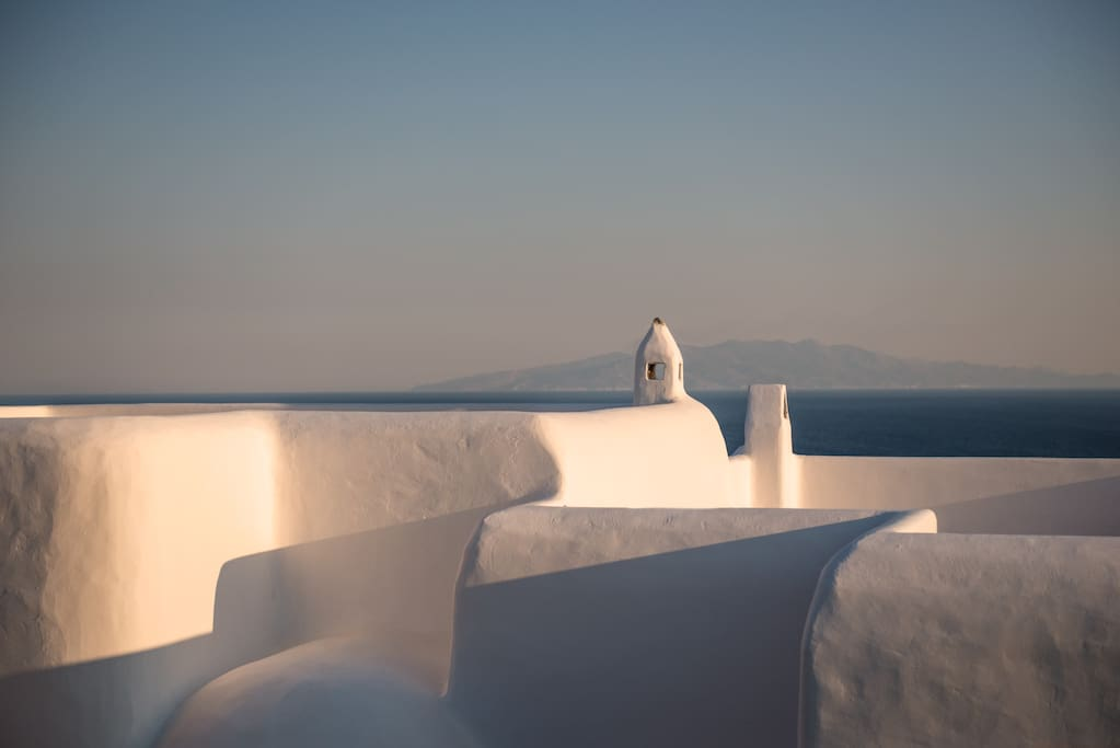 Authentic Cycladic architecture: cube shaped, flat roofed whitewashed walls