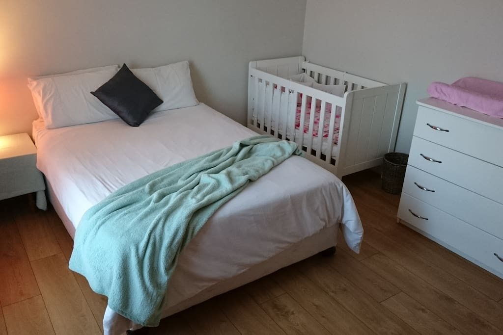 Spacious Guest Bedroom with Double bed, cot and compactum