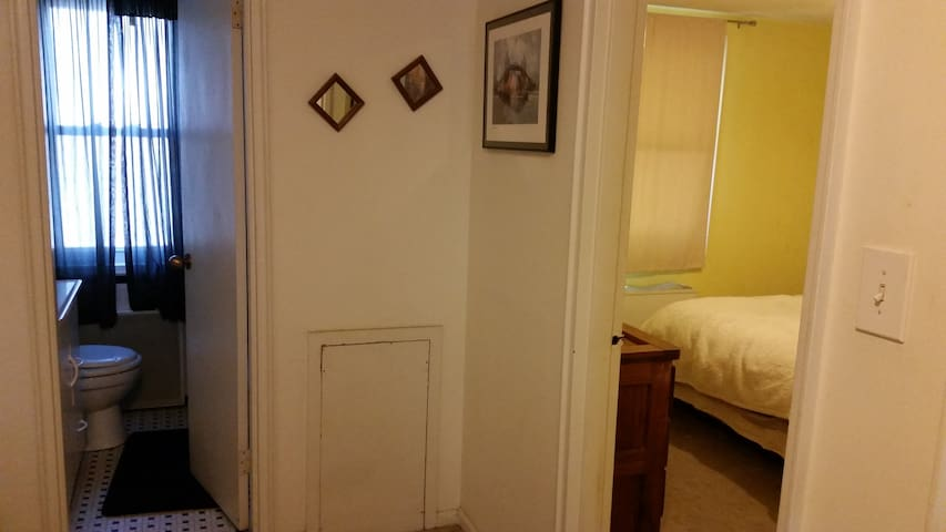 Shared bathroom is right next to the bedroom