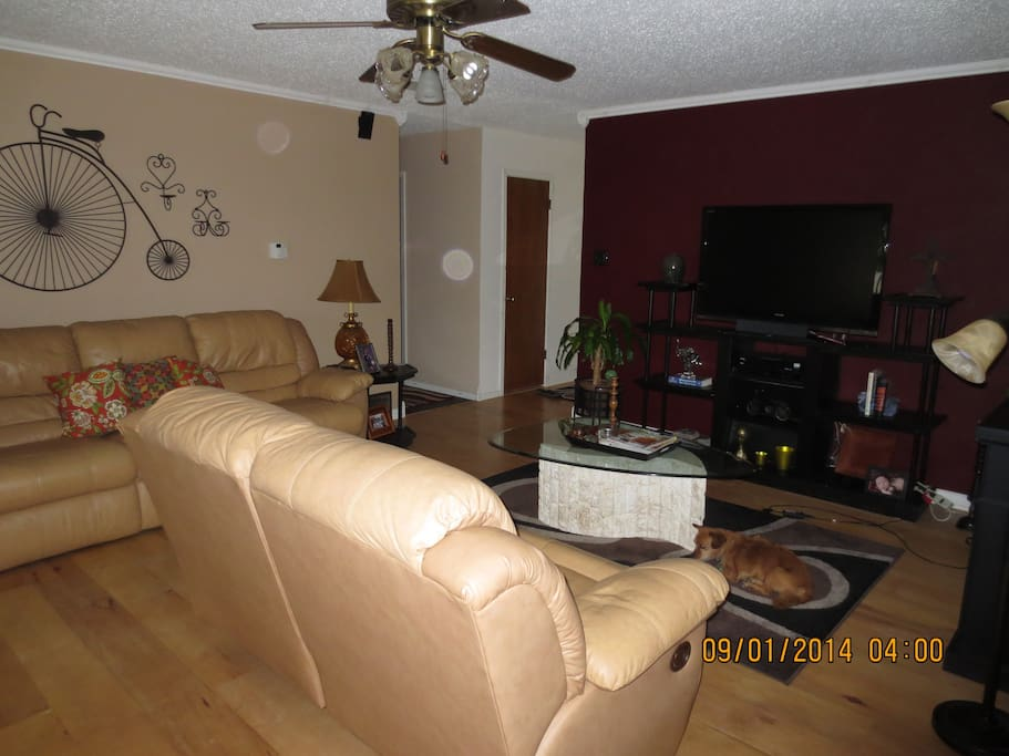 Another view of living room with big screen t.v.