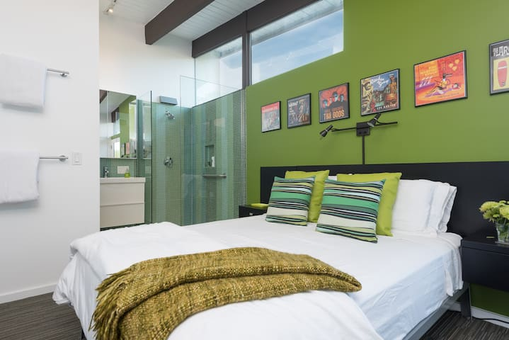 The green bedroom. Queen size bed with open glass shower...live out those water show fantasies!  Private outdoor patio as well.