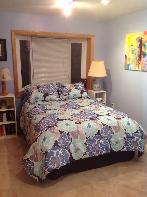 Double bed in blue bedroom.