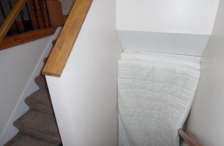 2 Floor Mattresses in Stairwell