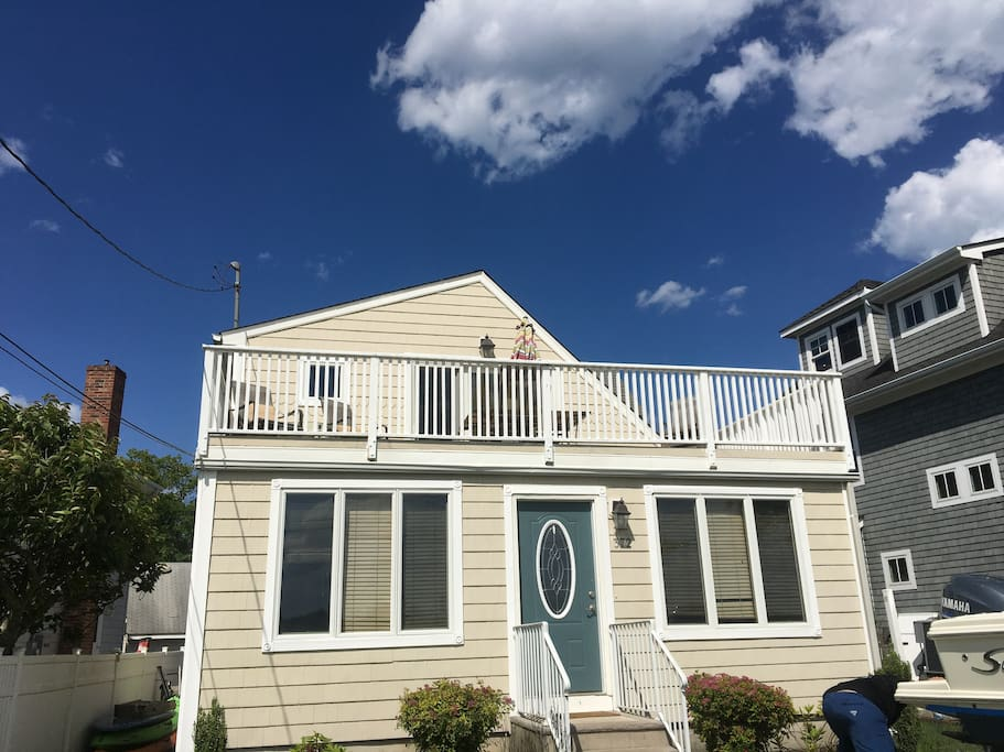 Front of home overlooking the waterfront with deck.