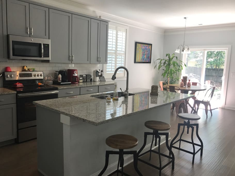 Kitchen with 3 stools and breakfast nook!!  Kitchen has American coffee maker and Nespresso machine for those that need their morning cup of Joe!
