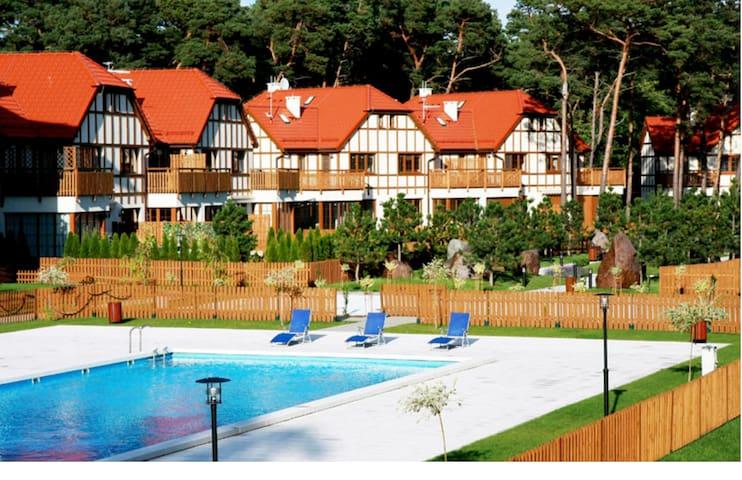 Piękny dom z dostępem do basenu - Rogowo - Casa