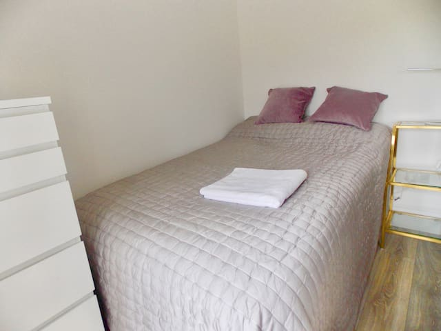 The small double bedroom ( for one) which overlooks open countryside. Large double built in wardrobe on the right of this  four foot wide bed.