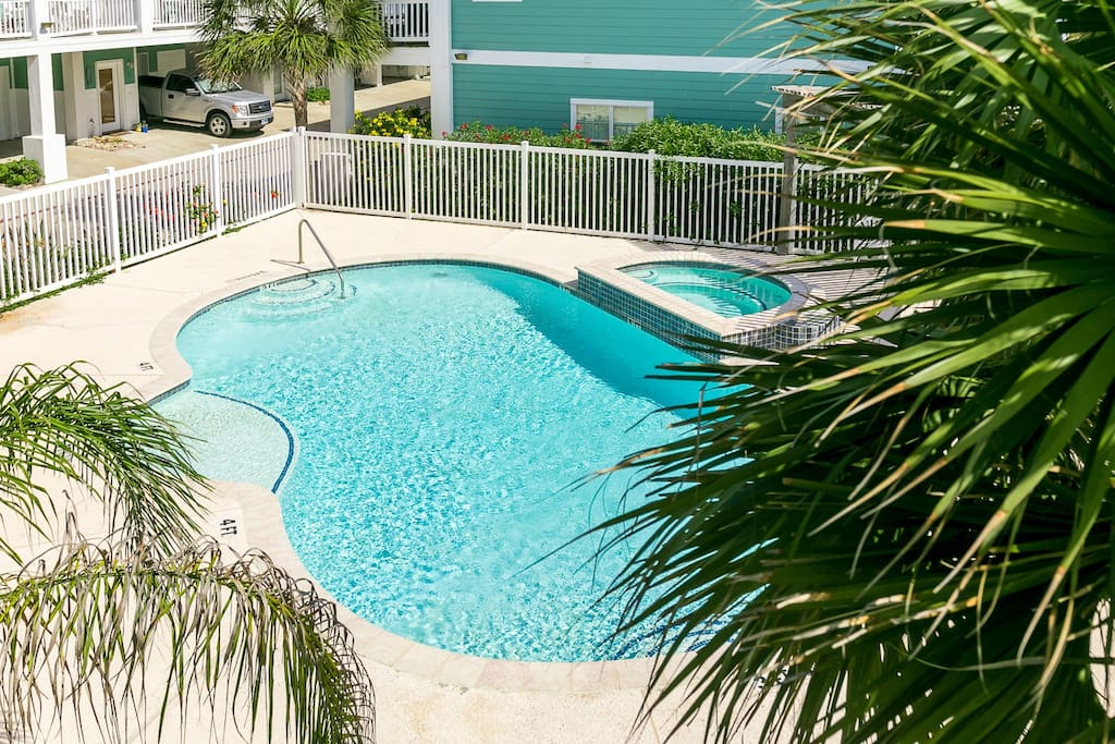 From the condo, you can see the sparkling community pool available for your use!