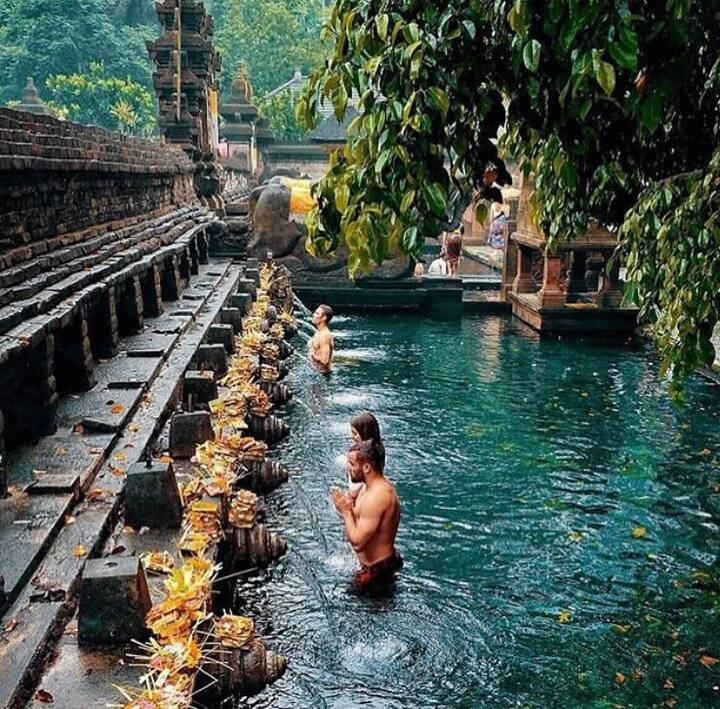 Spiritual cleaning at tirta empul temple