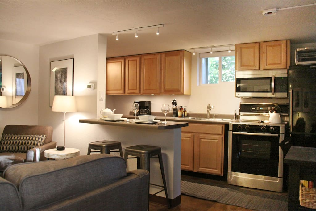 Well appointed kitchen with breakfast bar adjoins the living room.