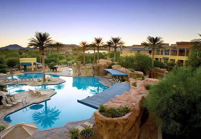 multiple pools with bars, music, kid play areas, etc.