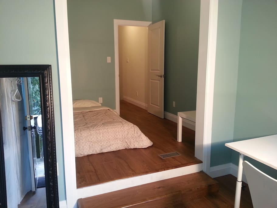 The bedroom door leads to the shared spaces.
