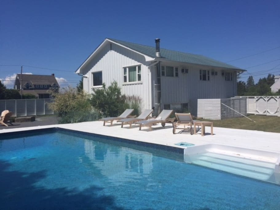 Fenced-In Backyard with Swimming Pool, Firepit and Lounge Area