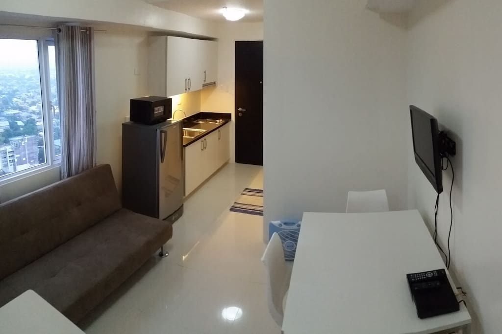 Corner Studio unit with views of New Manila and Quezon City.