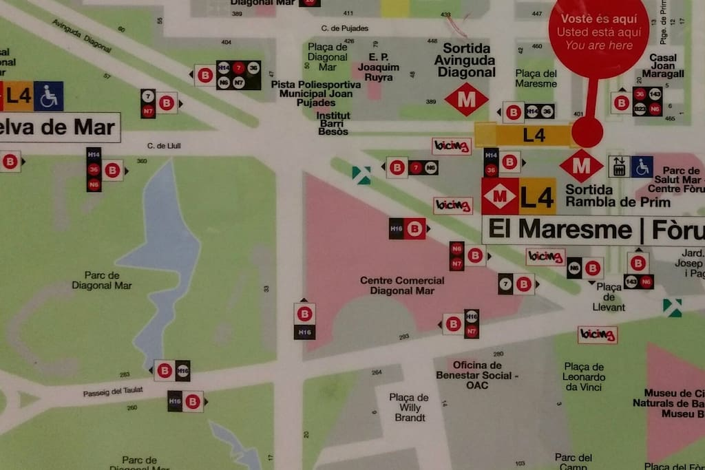 Take Metro L4 Yellow in direction to La Pau to stop at El Maresme | Forum (red cirlcle), exit Rambla de Prim. Our building is diagonally across the Rambla (next building behind orange Consum supermarket).