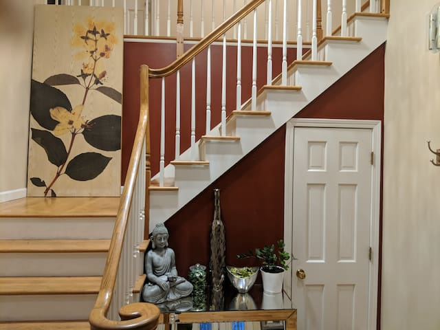Grand entryway; open & airy with extra wide stairs