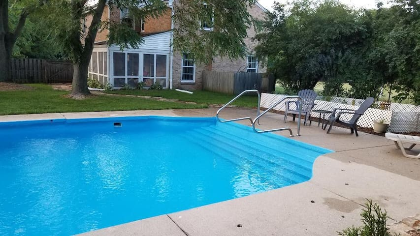 Fenced in backyard offers guests a large swimming pool for summer fun.
