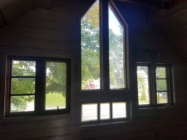 lots of windows make the room sunny and bright