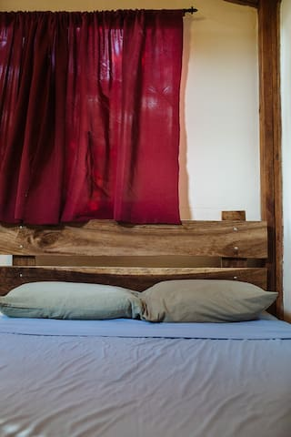 Hardwood headboards made from local trees that had to be cut down.  UpCycling