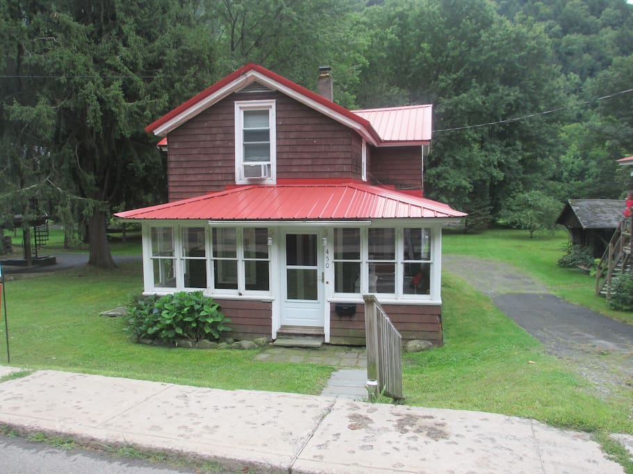 Our Home from the Road./...  Enjoy the enclosed porch with a book