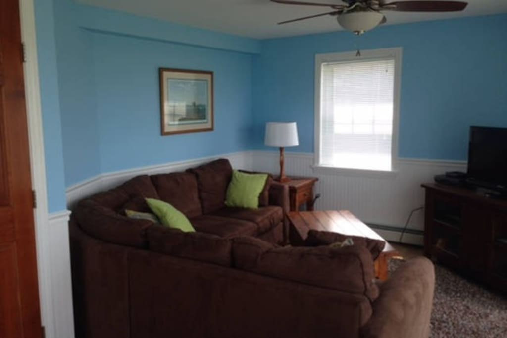 A spacious living room with a water view and access to the back deck