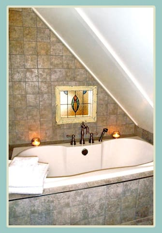 Upstairs bathroom with soaker tub.