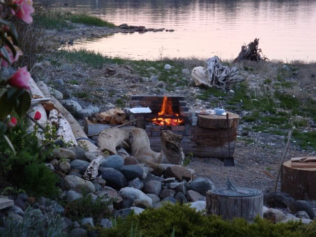 Charcoal BBQ and bonfire pit on the beach.