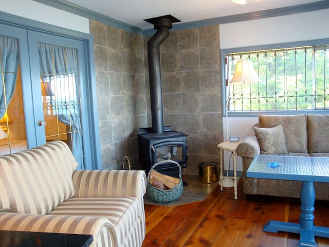 Livingroom with wood stove.