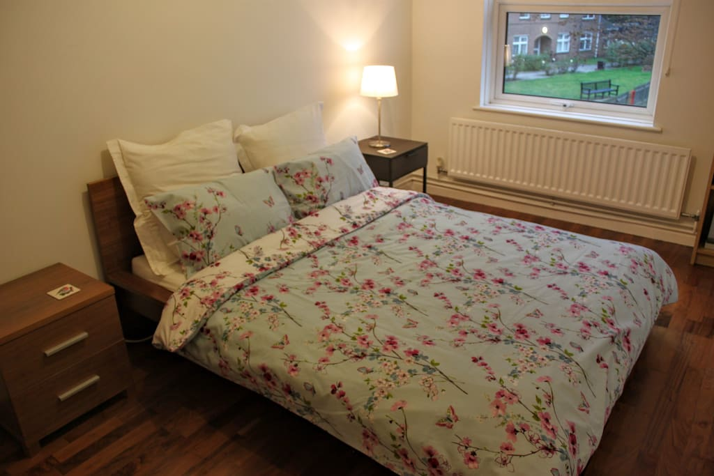 The double bed in the bedroom has a comfy memory foam mattress