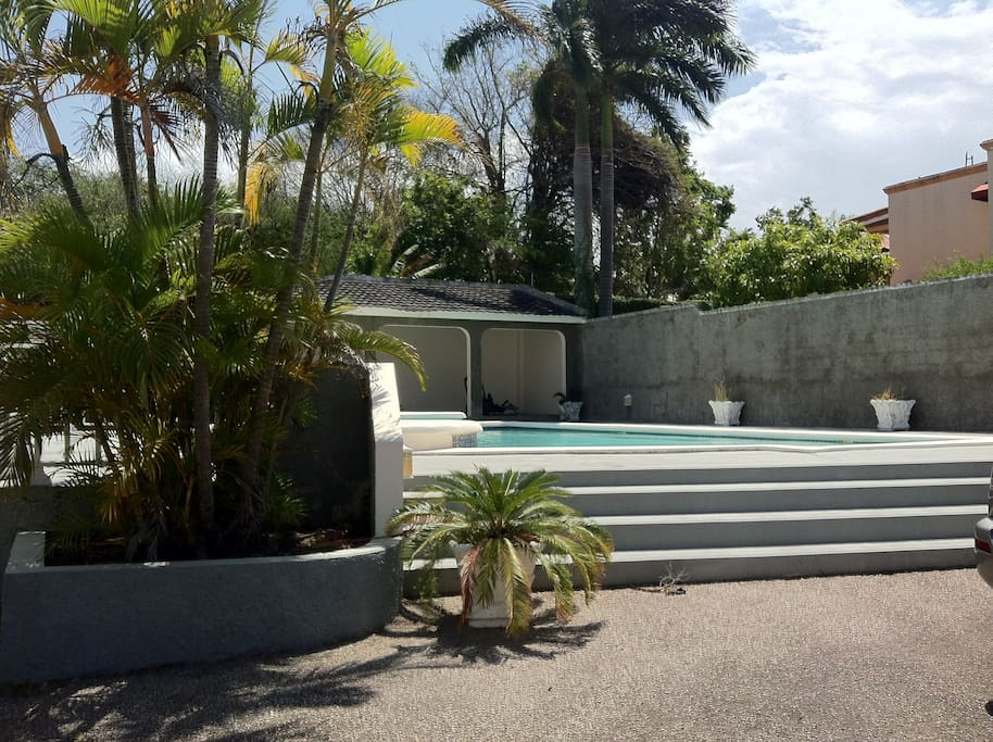 Stairs to pool beside townhouse