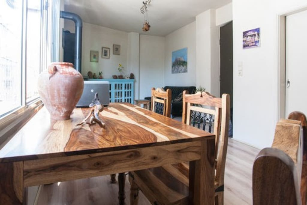 Handmade wooden table and chairs in living room.