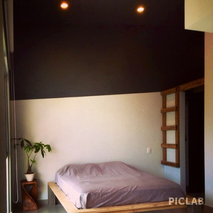 Queen size bed, loft space, 16ft ceilings