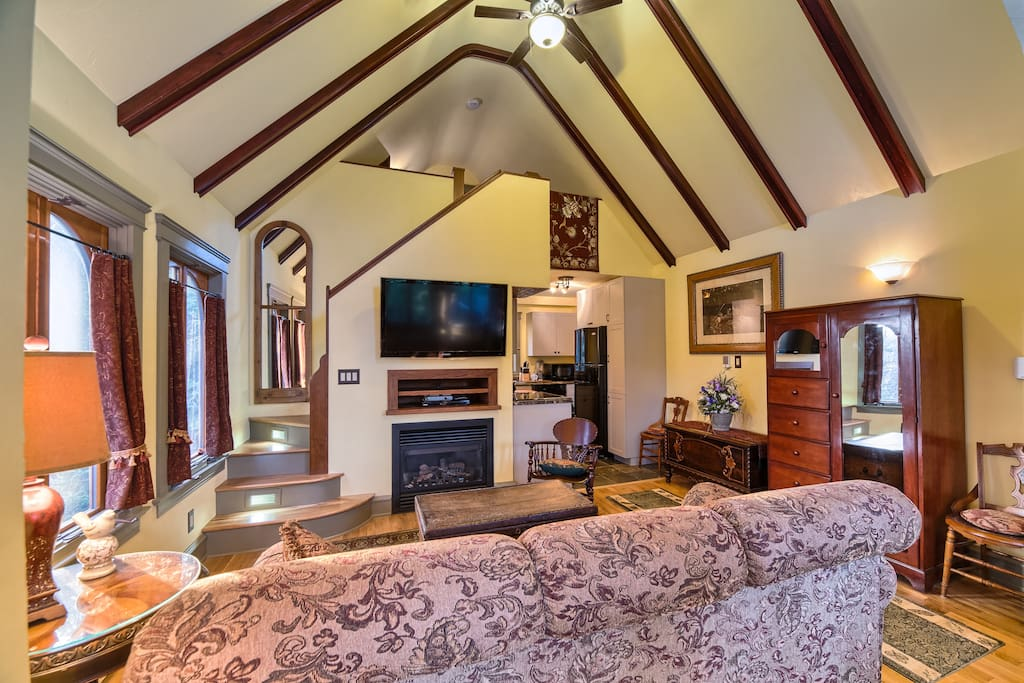 Inside you will find a cozy 450 square foot open-concept cottage with a living area that leads into a kitchen that includes a full size glass-top stove/oven, a microwave, refrigerator and dishwasher, and virtually every kitchen tool you need for daily coo