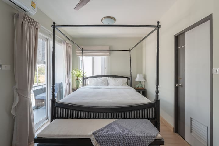 Bright and Breezy master bedroom with good sized balcony and outdoor sitting area.