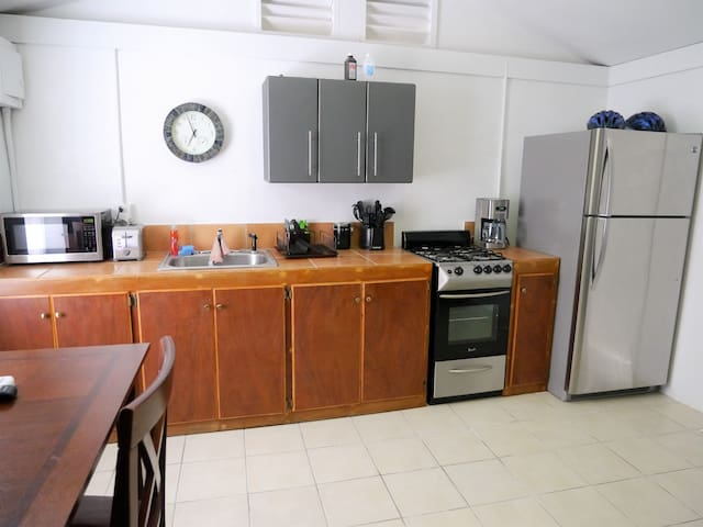 Full kitchen with upgraded stainless steel appliances. Refrigerator, Gas Stove with oven, drip coffee maker, Toaster and microwave.