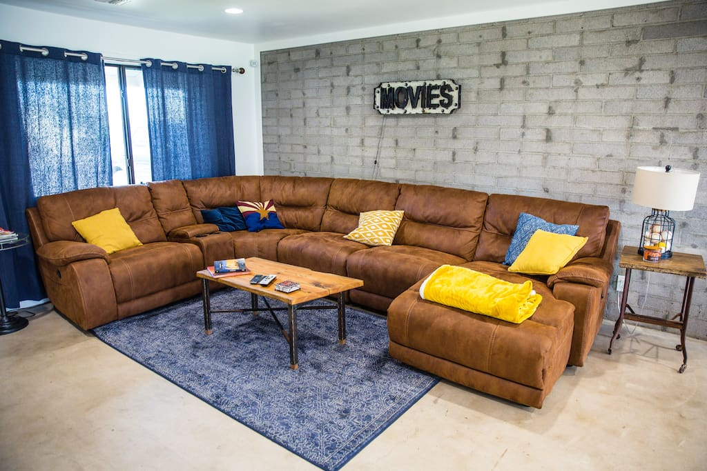 Spacious living room with reclining sectional.