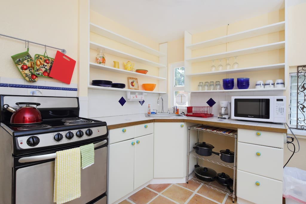 Kitchen - fully equipped with eating & cooking utensils