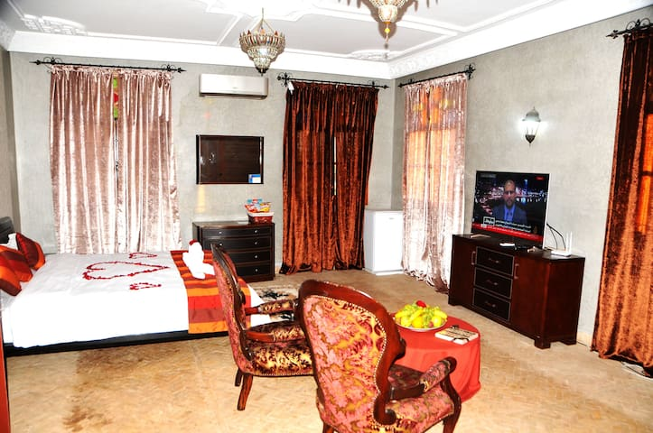 Deluxe Double Room with private bathroom TV, computer and sitting area